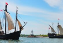 two old ship replicas on the water