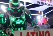 "robot holding sign that says ""latino festival"""