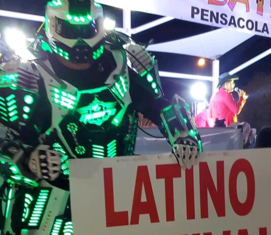 """robot holding sign that says """"latino festival"""""""