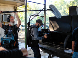 Camera crew recording meat on a grill