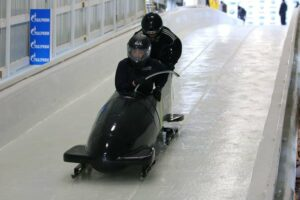 two people racing on a bobsled