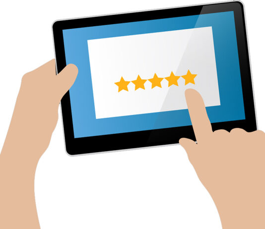 illustration of hands selecting star ratings on tablet
