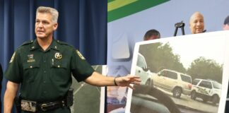 Sheriff pointing at photo of car