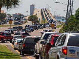 heavy traffic leading to a bridge