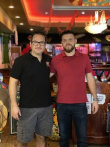 two men standing in a restaurant