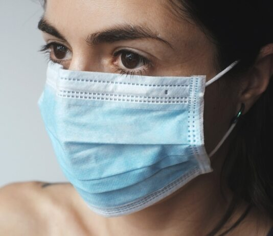 person wearing a medical face mask