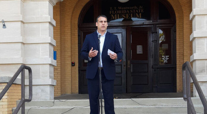 man standing addressing a crowd