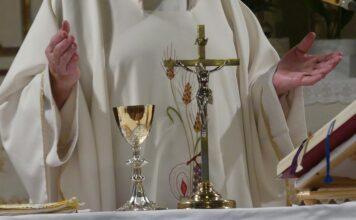 priest offering mass