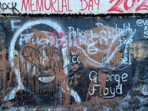 defaced mural of George Floyd