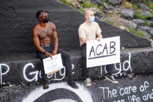 two protesters holding signs