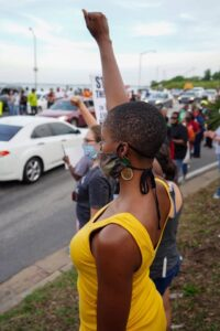 protester holding a fist up