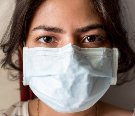 person wearing medical face mask