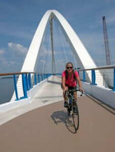 Bicycle rider riding across the bridge