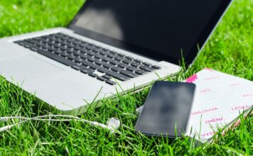 laptop and smart phone on grass