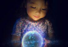 child holding globe