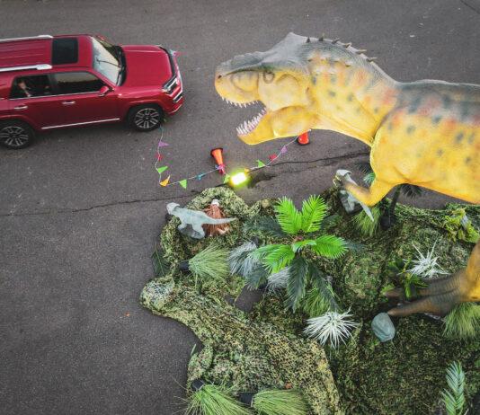 dinosaur looking at car