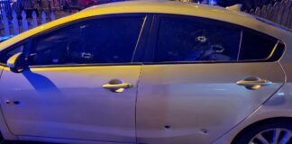 car with bullet holes in rear doors