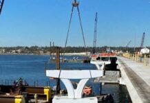 Pensacola Bay Bridge trophy being installed