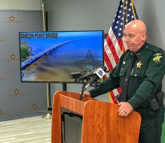 Sheriff Johnson standing at a podium