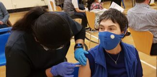 Person receiving a vaccine injection