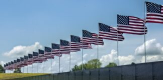 Vietname Memorial Wall with American flags
