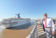 Mayor Stimpson standing next to Carnival ship