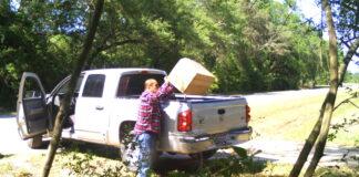 Man dumping trash on roadside