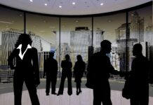 Silhouettes of business people networking